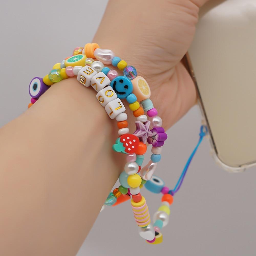 New Trendy Handmade Beaded Acrylic Eye Fruit Beads Imitation Pearl Phone Chain for Women Soft Pottery Anti-lost Phone Strap