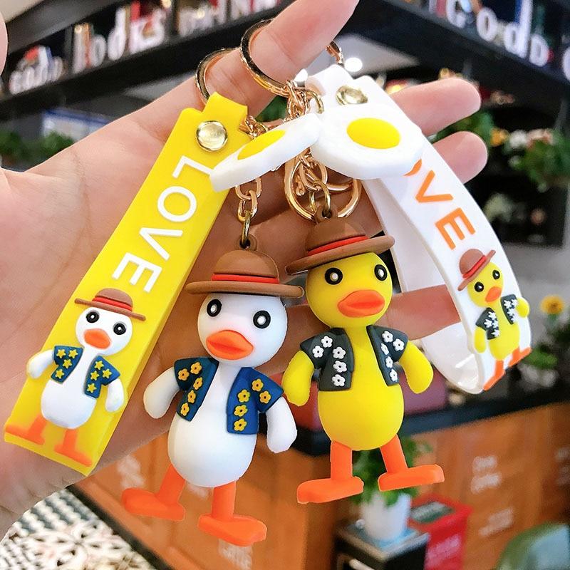 Encantadora gota de pegamento Hello Duck llaveros huevo de dibujos animados yema pato clave acoplador creativo mochila colgante Ins llavero de moda