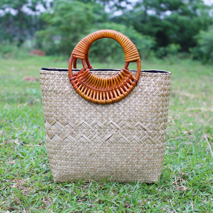 El nuevo paquete de terciopelo retro de moda versión tailandesa de la mano tejida mano de las mujeres de hierba paquete para el pasto paquete bolsa de playa