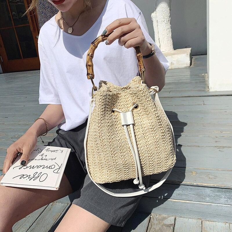 Bolso de mujer de moda 2020 Bambú de lujo portátil solo hombro paja trenzado todo-fósforo Slant Straddling bolso de cubo mejor venta