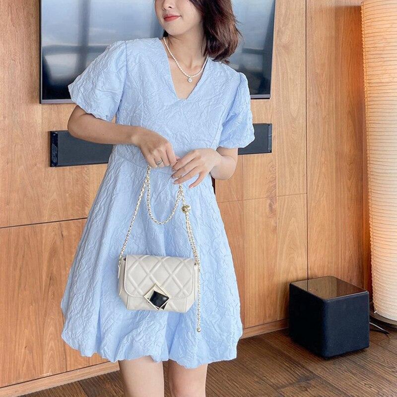 جلد حقيبة صغيرة الإناث 2021 جديد حار نمط الإناث حقيبة صغيرة Xiangling حقيبة سلسلة حقيبة الموضة رسول حقيبة كتف