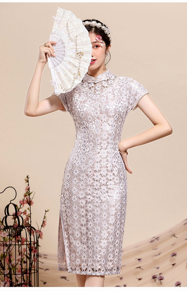 Cheongsam 2020 new modified version of the fashionable young girl nail bead temperament famous thin middle and long summer 2020 new summer new style cheongsam section temperament young section student girls cheongsam improved version of thin dress