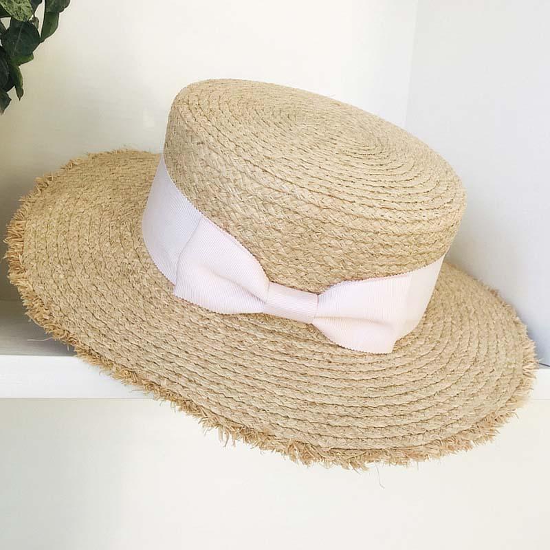 Sombrero de paja rafia de ala ancha transpirable a la moda, sombrero de sol de playa de barco plano, Lazo de cinta, sombrero de verano para mujer, venta al por mayor