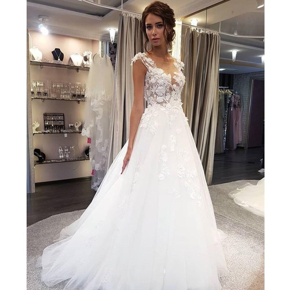 Vestidos De novia blancos con Apliques De encaje Línea A sin mangas ilusión Barre Train vestido De novia con botones traseros Robe De Mariage