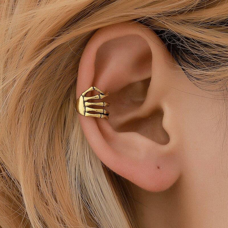 Moda metal crânio mão punk orelha manguito cartilagem sem piercing brincos falsos jóias clipe de ouro cor brincos para mulher