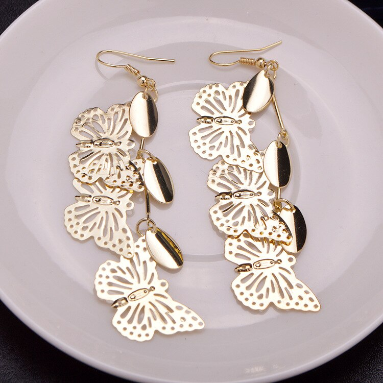1 par de pendientes huecos de tres mariposas tipo gota de moda párrafo elegante joyería única clásica caliente colgante