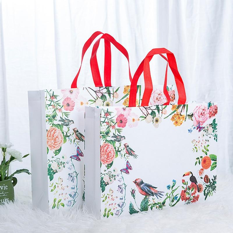 Bolsa de compras con estampado de flores de moda, bolsa ecológica de alta calidad, bolsa de viaje para comestibles, bolsa plegable de tela no tejida con flores, gran oferta