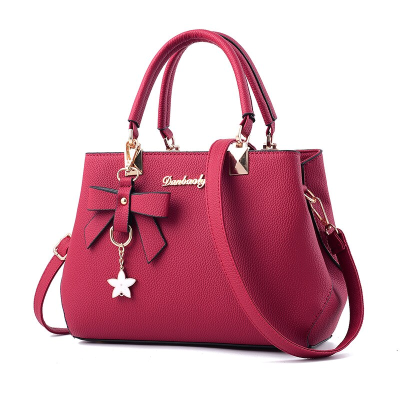 2020 nueva versión coreana de la moda Otoño e Invierno bowknot femenino bolso de hombro portátil messenger bag killer bag madre
