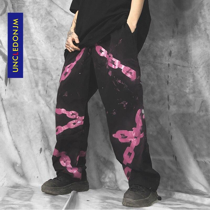 UNCLEDONJM łańcuszkowe spodnie z nadrukiem męskie hip-hopowe proste spodnie dorywczo sznurkiem luźny krój spodnie Swag moda uliczna męskie spodnie