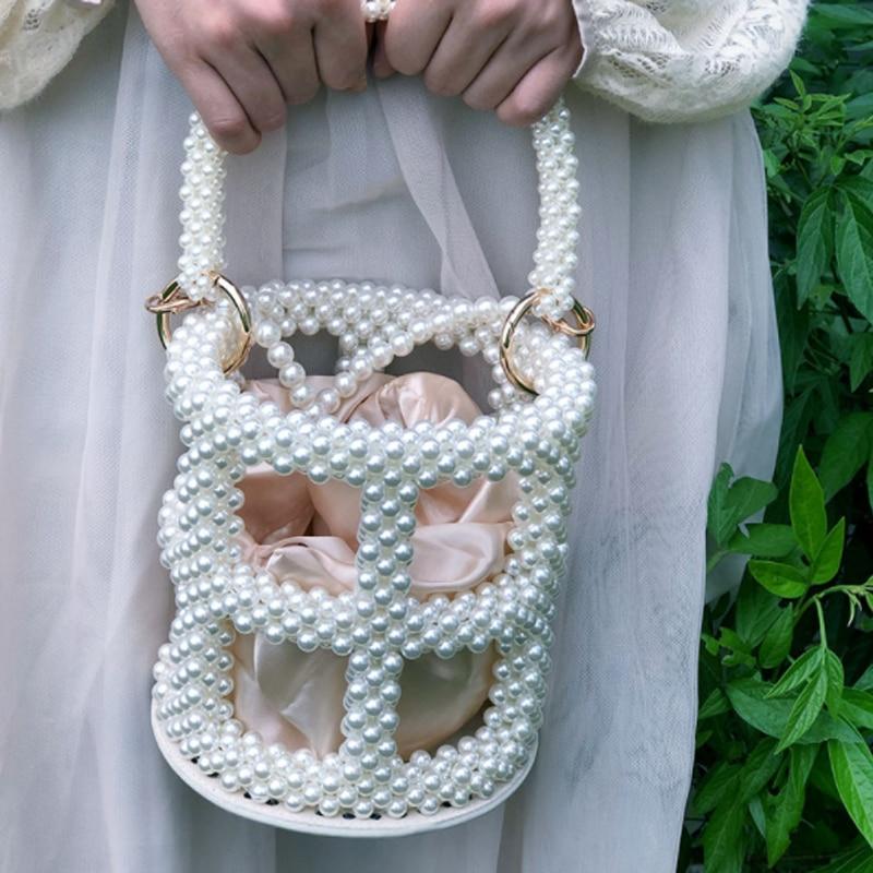 حقيبة دلو فاخرة مصنوعة يدويًا 2021 حقيبة يد نسائية جديدة مجوفة من اللؤلؤ حقيبة حقيبة حفلات