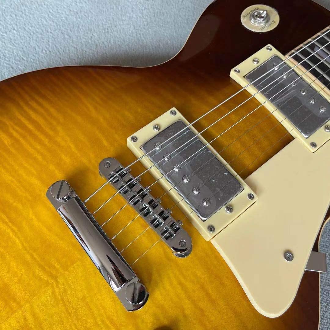 Custom shop.Sunburst color Electric Guitar.Frets binding.Ebony fingerboard.Mahogany body.Tiger Flame maple top gitaar. enlarge
