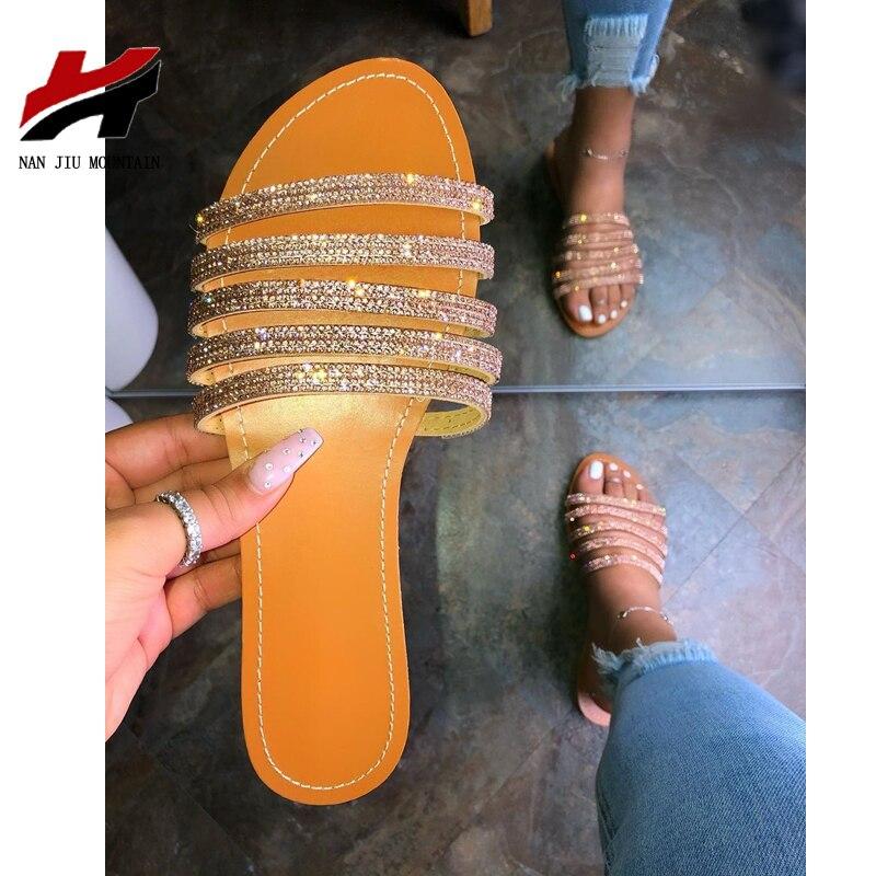 Nan jiu montanha 2020 mulher chinelos sandálias de verão plana sapatos femininos dedo do pé aberto fonte de moda sexy vento romano plus size 38-42