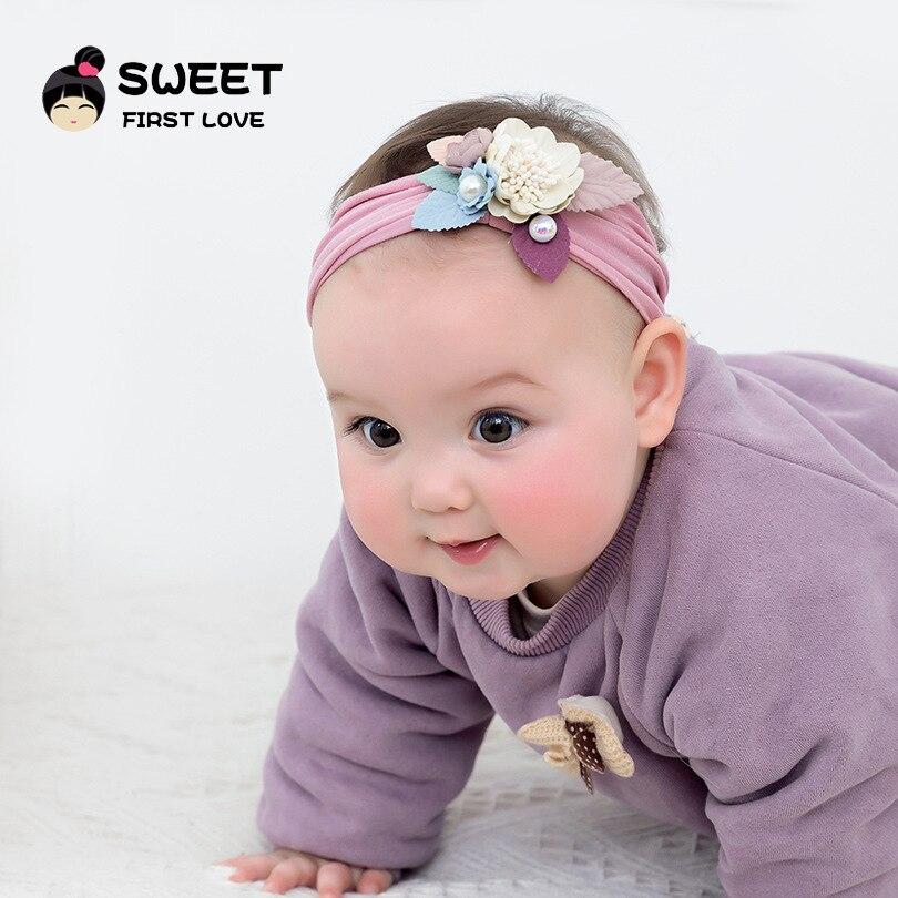 2019 Europa y América nuevo estilo niños Super suave tocado sin costuras 3-Color moda Junta flor bebé Nylon pelo ancho