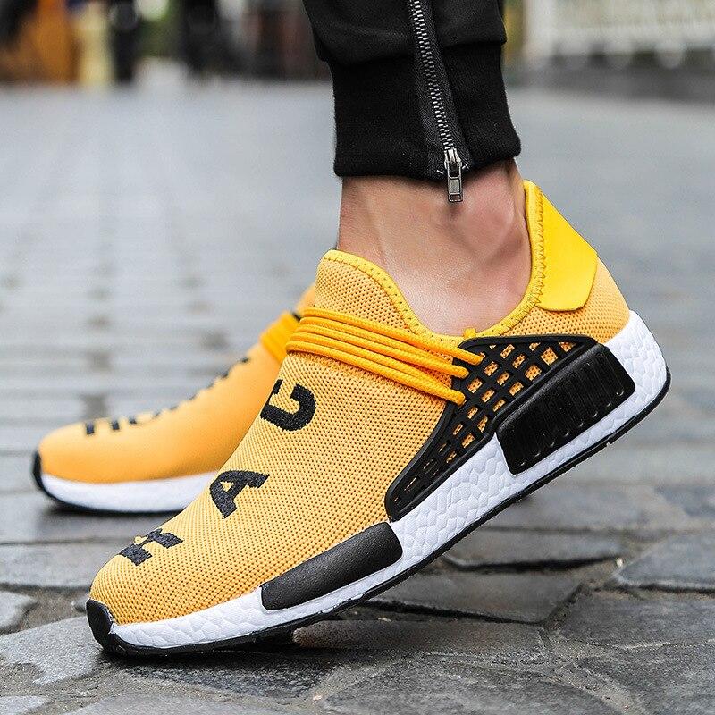 الأصفر الإنسان سباق أحذية رياضية الرجال النساء حذاء كاجوال للجنسين موضة تنفس في الهواء الطلق ضوء المدرب أحذية مشي تنيس Masculino