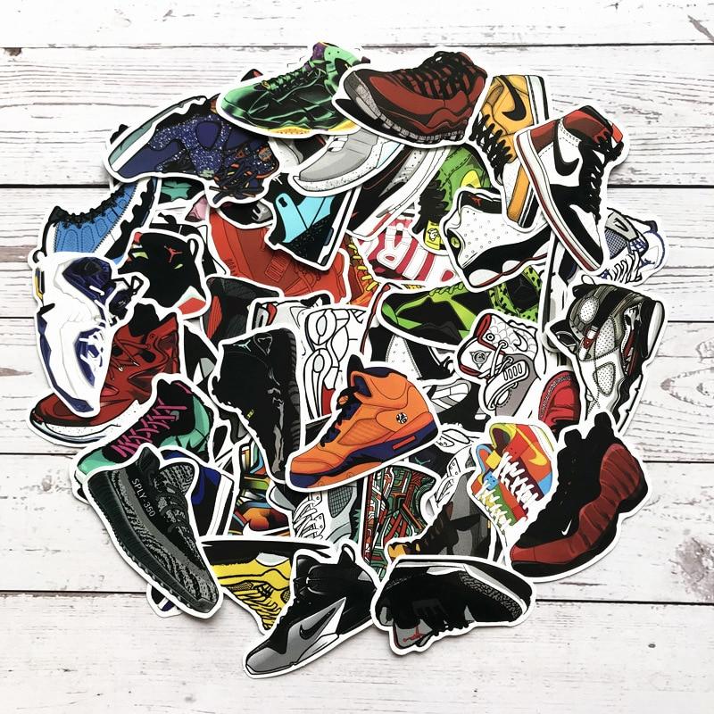 100 Uds de dibujos animados AJ zapatos pegatinas mezcladas zapatillas de deporte Jordan pegatinas para bicicleta de equipaje caja portátil Graffiti impermeable pegatinas