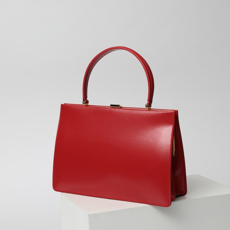 Women's bag 2021 new clip design bag leather business handbag celebrity street photography leather handbag professional handbag