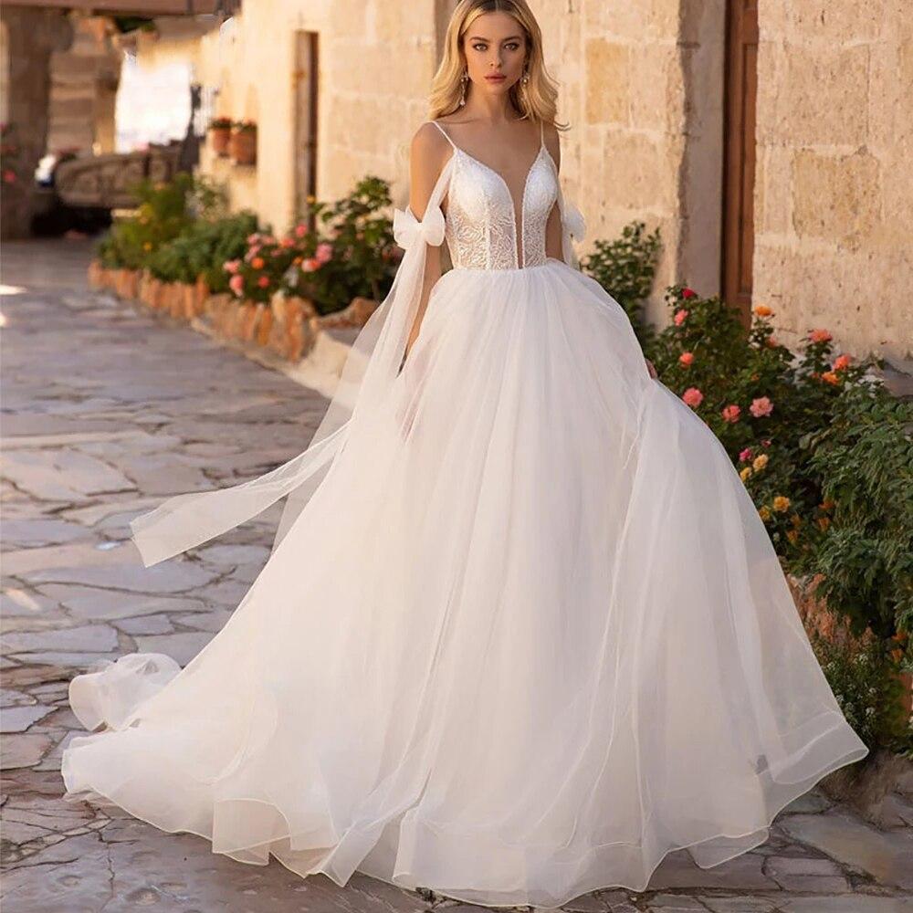 Promo Boho Spagehetti Straps Wedding Dresses 2021 Elegant Appliques Sleeveless V Neck Tulle A Line Backless Sweep Train Bridal Gowns