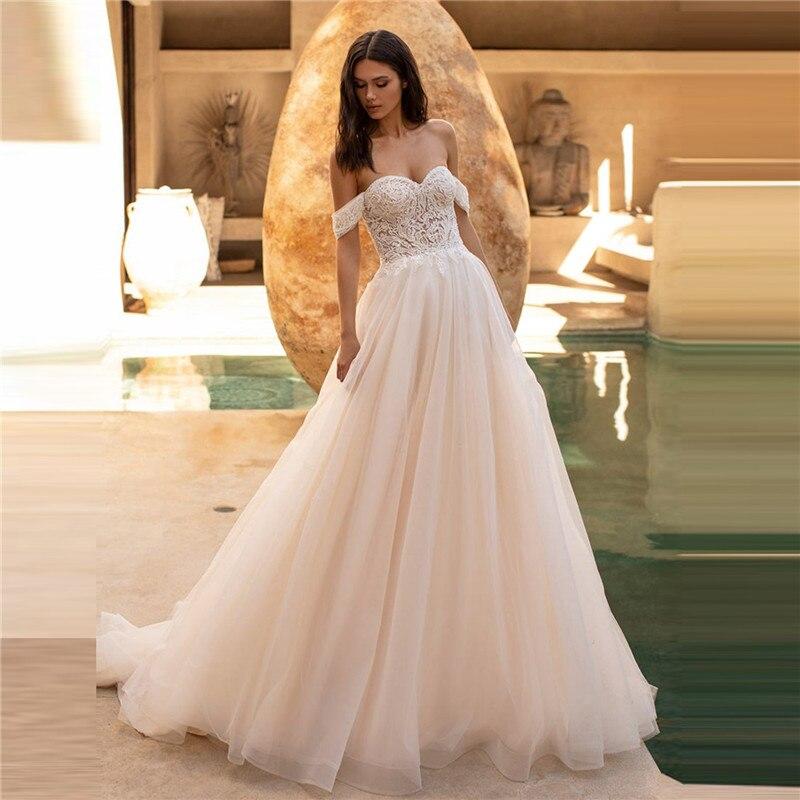 فساتين زفاف قصيرة الأكمام مزينة بالدانتيل على الكتف A Line Champagne فساتين الزفاف Vestido de Noiva العرائس الرسمية 2021