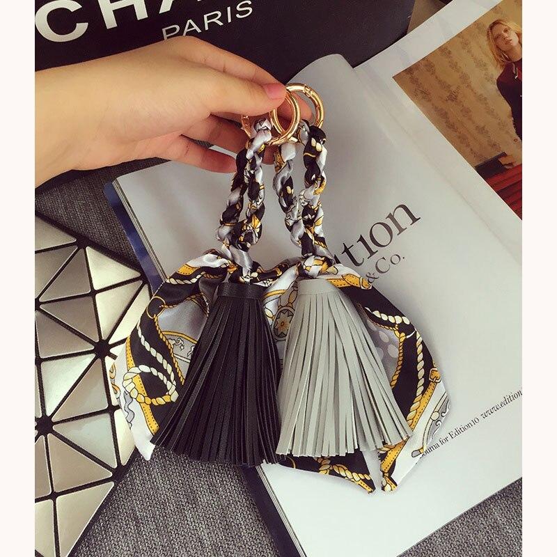 Bufanda de seda de cuero borla señora creativa borla colgante llavero de coche mujer moda personalidad sencilla bolsa adornos colgantes