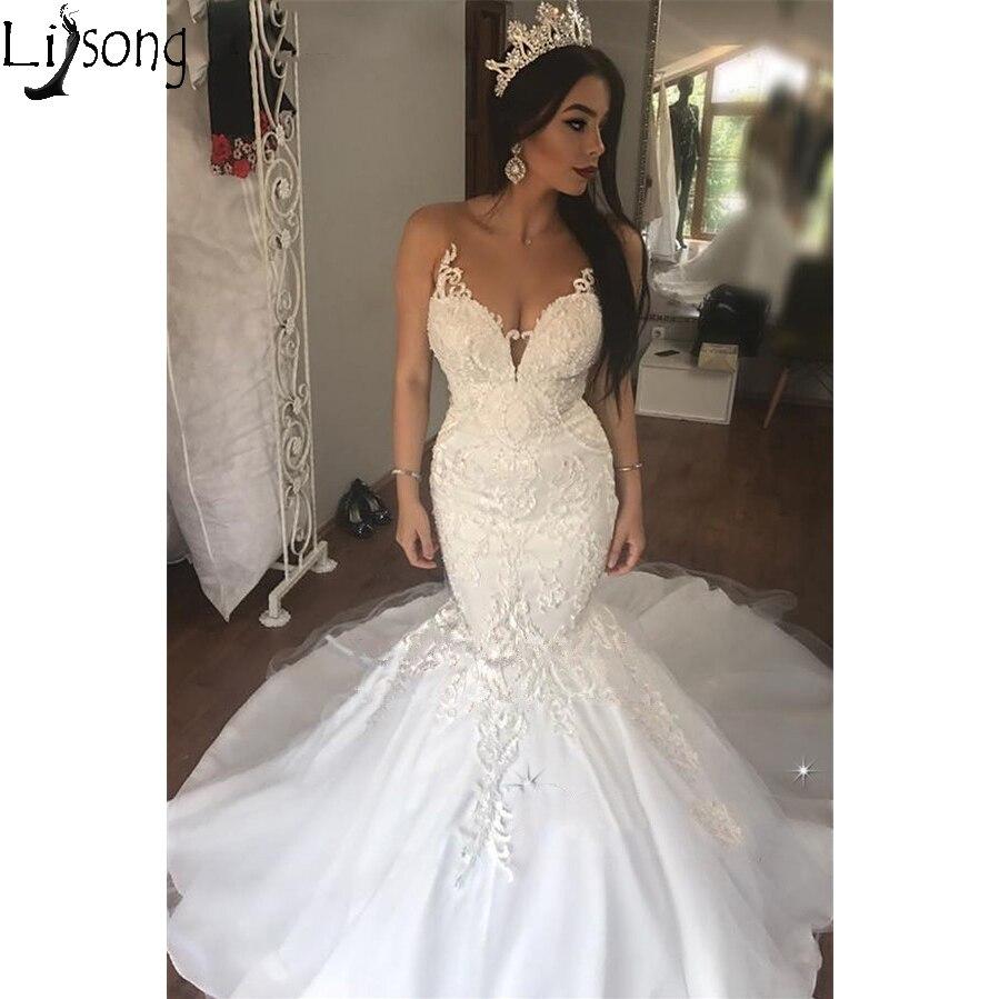 Vestidos de boda africanos de sirena de encaje Vintage 2019 ilusión cuello en V apliques elegante vestido de novia blanco corte tren vestidos de boda
