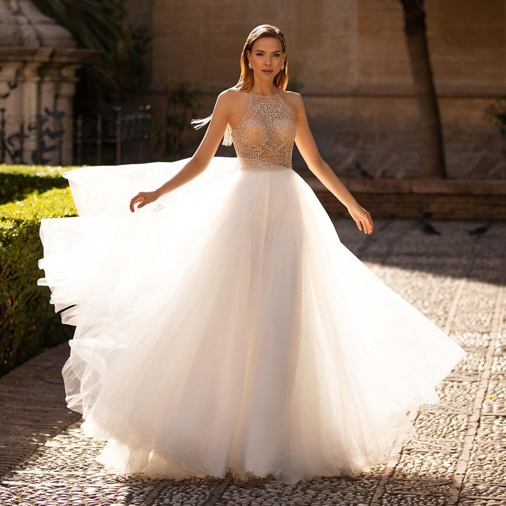 فساتين زفاف سباركلي رسن a-line مطرز بالخرز بدون أكمام دانتيل بدون ظهر فرشاة ذيل جوفاء تول جسر ثوب Vestido De Novia