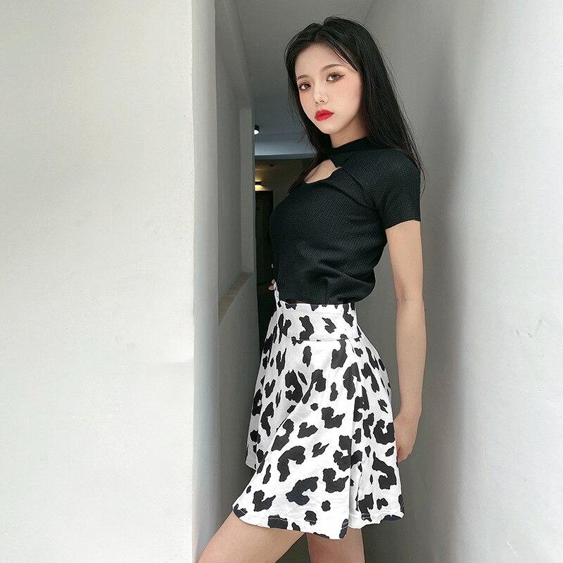 Moda estética mujer falda negro y blanco costura estampado de vaca cintura alta suelta A-line sexy slim mini falda verano streetwear