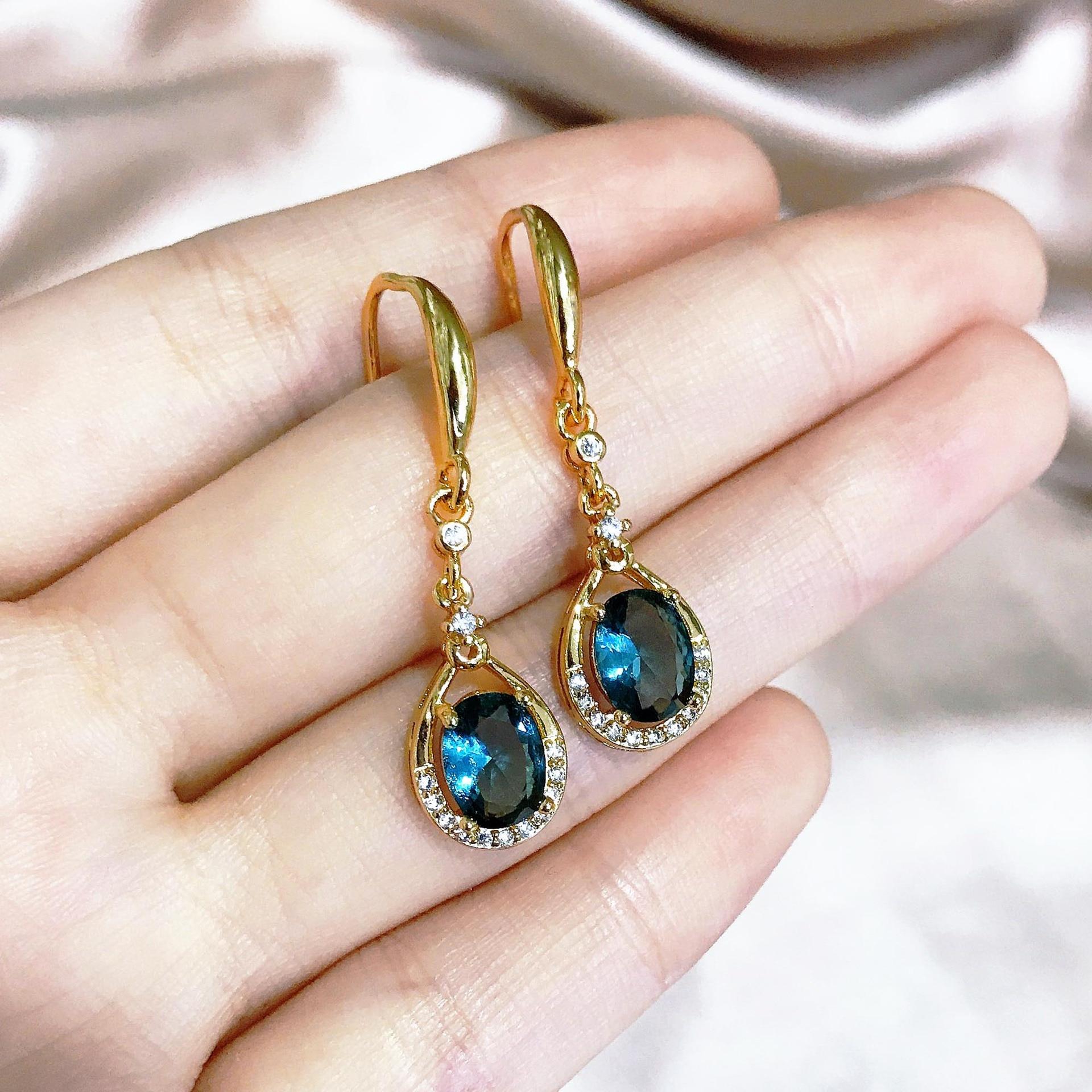 Серьги-женские-из-серебра-925-пробы-с-голубым-сапфиром-14-К-желтого-золота