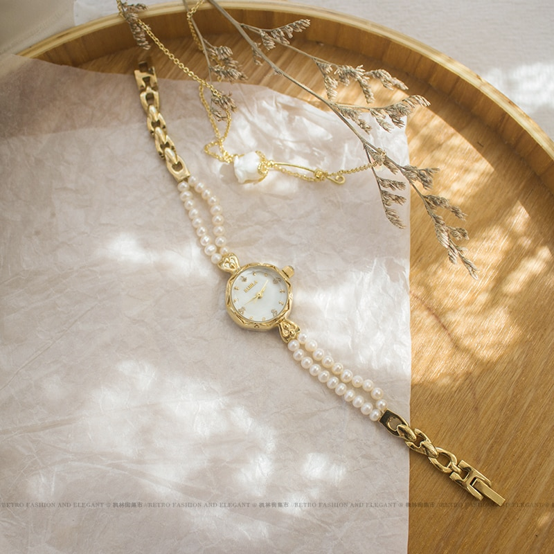 2021 new Japanese watch light luxury pearl strap vintage watch female student art small gold watch French elegant quartz watch L enlarge