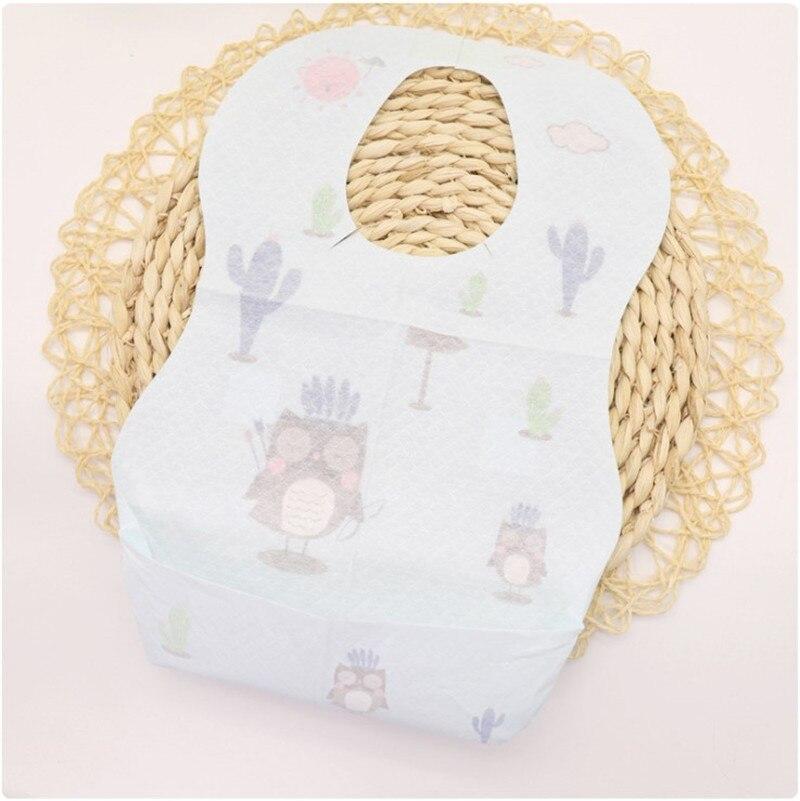 20 unids/lote impermeable tela no tejida desechable bebé niño Baberos alimentación Saliva delantal de papel de dibujos animados portátil Baberos