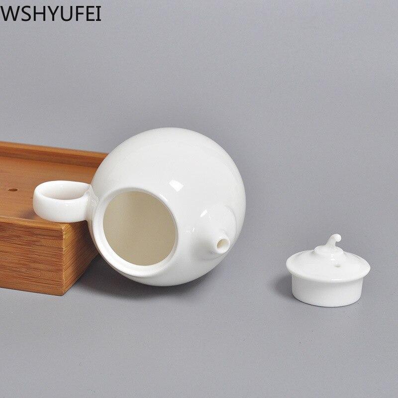 Juego de té y tetera blanca de porcelana de lujo hecha a mano, juego de té y tetera china, juego de vino doméstico