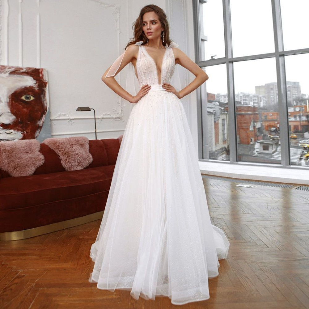 Review A-Line Deep V-Neck Tulle Wedding Dress Sleeveless Backless Beading Pearls Pleat Sweep Train Bridal Gowns 2021 Vestido De Noiva