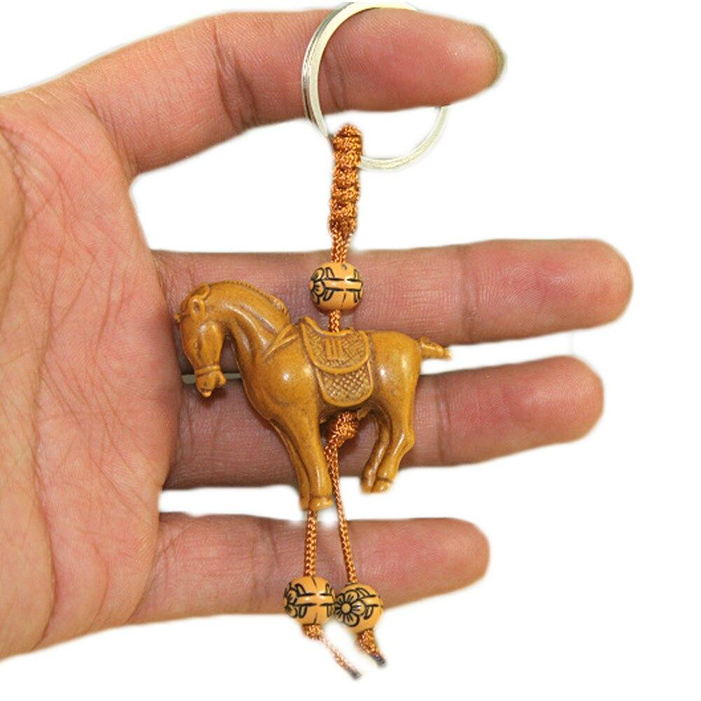 Clásico elefante de la suerte caballo tallado colgante de madera llavero el mal protege el regalo presenta la decoración del sostenedor