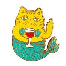 Drôle de broche Mercat ivre en or enflammez votre imagination et entrez dans la mer bleu profond avec cette sirène de chat