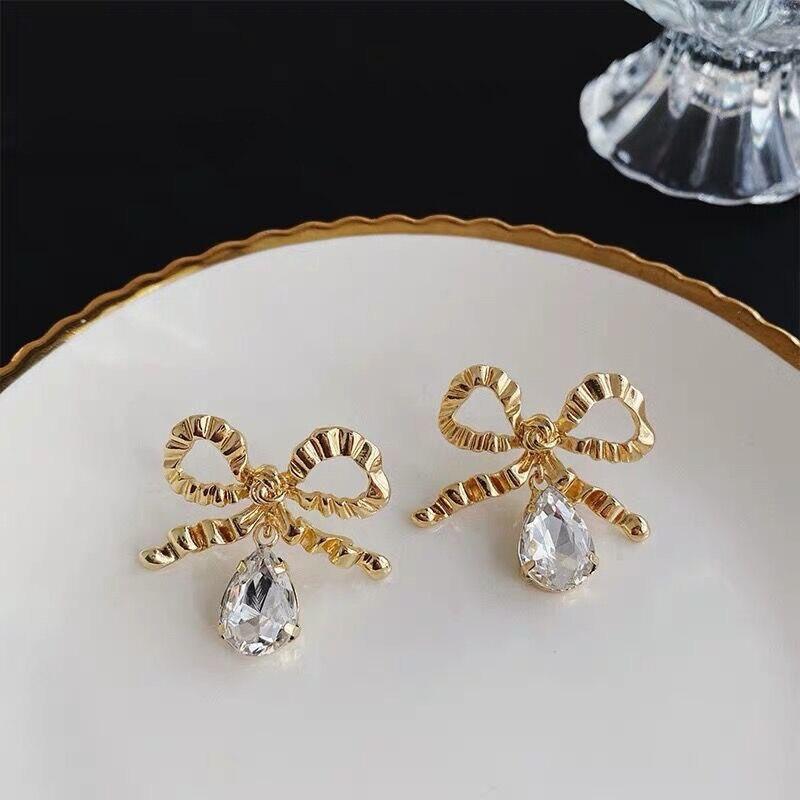 Pendiente de lazo con textura grande brillante dorado para mujer joyería de moda