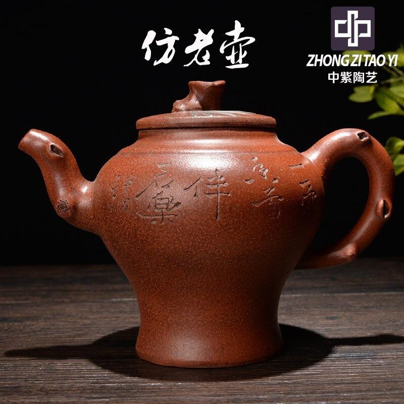 En púrpura Yixing la dinastía Ming imita la vieja tetera de cerámica esmaltada de color rojo oscuro el reflujo de Taiwán imita el viejo hervidor de agua una fábrica