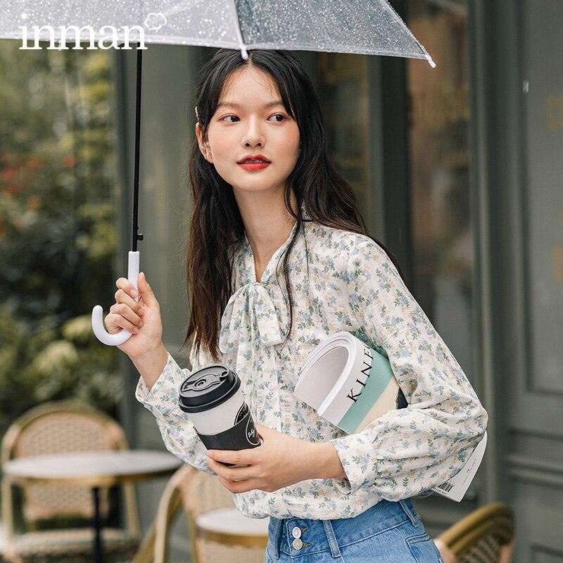 Inman 2020 outono nova chegada azul fresco floral laço colarinho mangas compridas solto com decote em v blusa