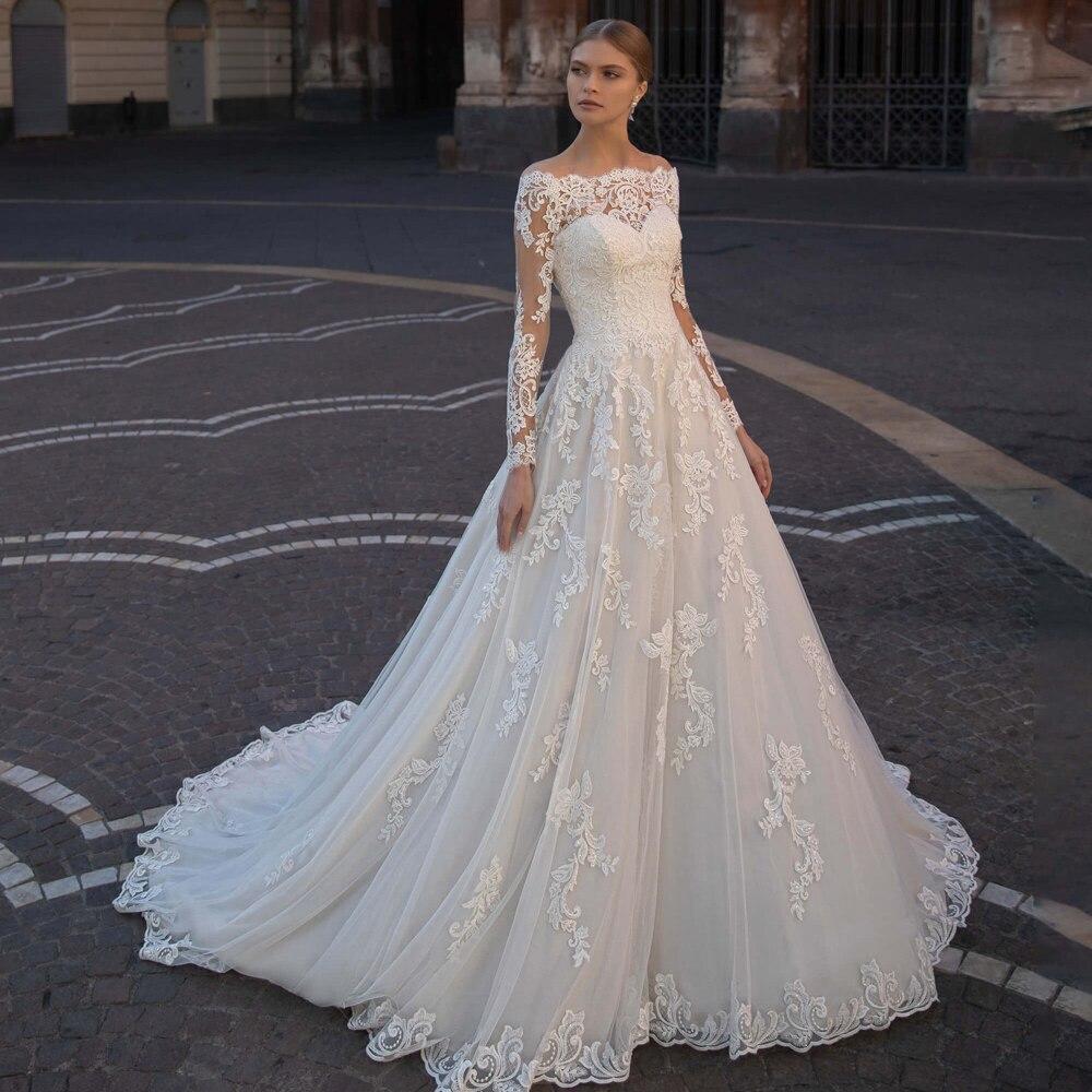 فستان زفاف رومانسي على الطراز البوهيمي ، ياقة قارب ، خط a ، أكمام طويلة ، زينة عتيقة ، 2021