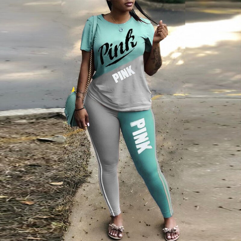 ملابس رياضية نسائية صيفية وردية موضة 2021 ملابس ذات رقعة مطبوعة عليها حروف قمصان وبنطلون ضيقة بنطلون ضيق