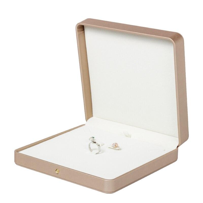 Nueva caja de joyería cuadrada de cuero Pu Champagne Gold para almacenar y mostrar anillos collares pendientes y Super rentable