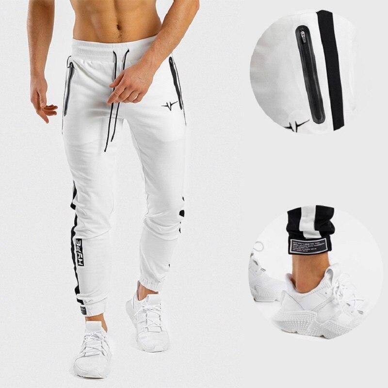 Pantalones de Fitness hombres nada elástico Pantalones ceñidos hermanos corriendo Casual Pantalones...