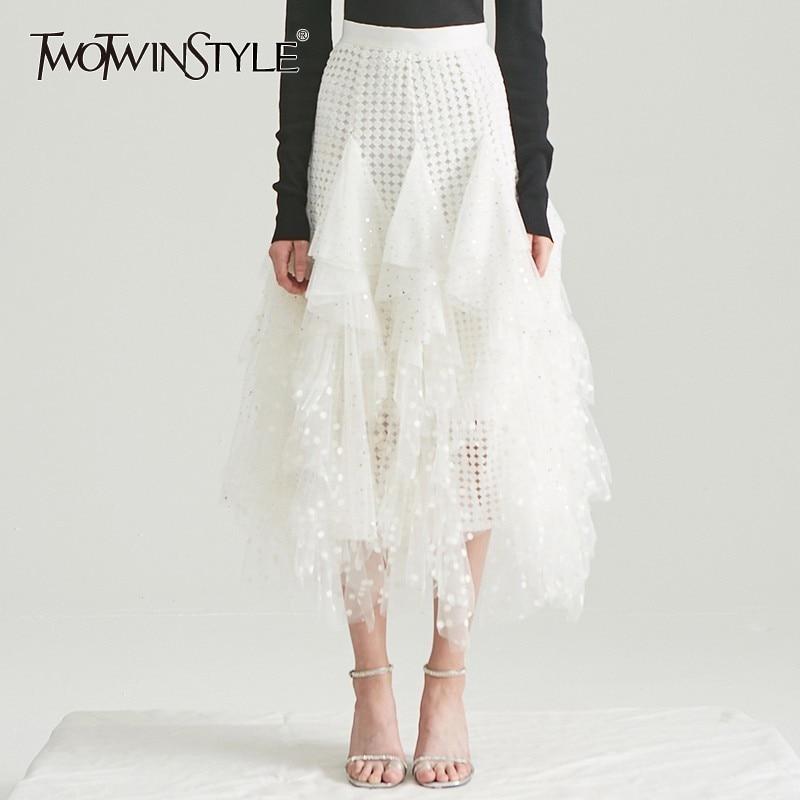 TWOTWINSTYLE Hollow Out Polka Dot mujeres falda de alta cintura de malla Irregular medio Faldas de mujer casual coreano 2020 primavera moda nuevo