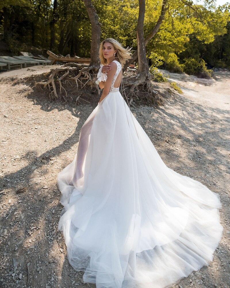 Купить с кэшбэком 2019 Boho Wedding Dresses Jewel Sleeveless Lace Appliques Bridal Gowns Sweep Train A Line Wedding Dress Robe De Mariee