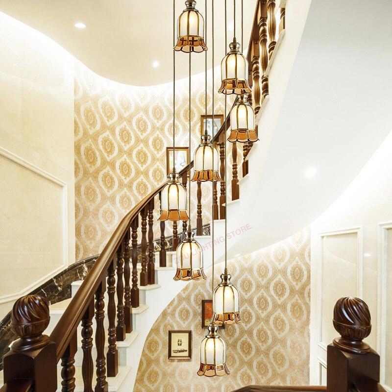 Candelabro de escalera led de cobre estilo europeo villa. Iluminación decorativa giratoria de gran altura. Lámpara colgante en el piso superior