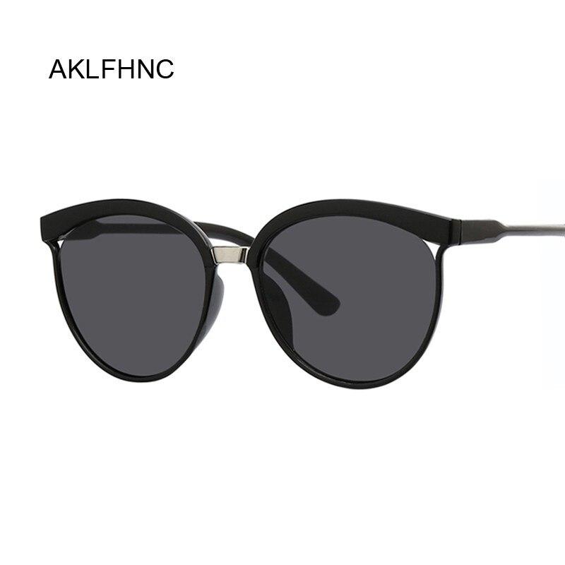 Gafas de sol de ojo de gato negras sexis para mujer, gafas de sol de marca famosa de lujo, nuevas gafas de sol de diseño a la moda para mujer, pequeños puntos blancos UV400