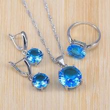 Prix le plus bas, le style le plus classique couleur argent ensemble de bijoux fantaisie pour les femmes pendentif collier boucles doreilles anneau cadeau de noël