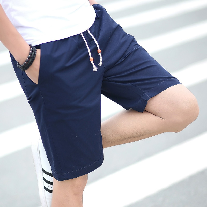 Pantalones informales de algodón con movimiento en L para hombre de verano 2019, pantalones y pantalones largos hasta la pantorrilla para la playa Cinco Pantalones una generación de grasa para hombre