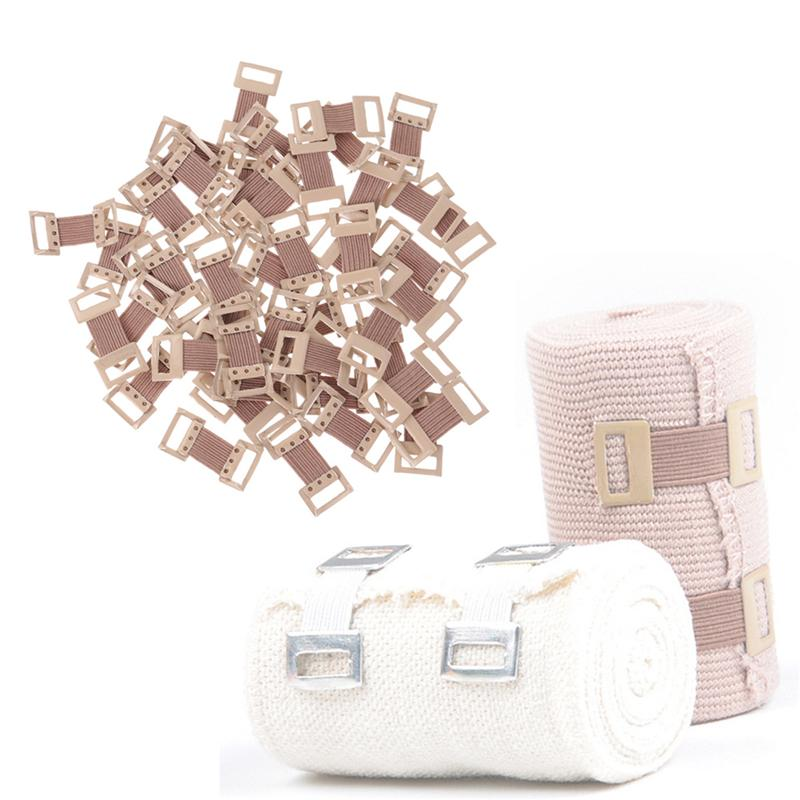 Os grampos elásticos da atadura de 50 pces esticam os fechos do metal para vários tipos ataduras