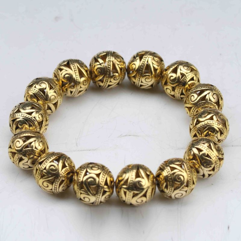 China tibetano plata dorada tallada a mano ahueca hacia fuera pequeña pulsera de bola