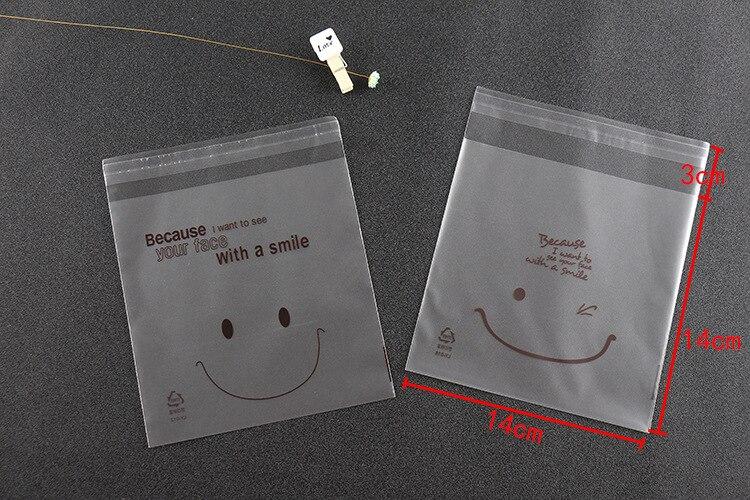 Frete grátis 10*10 14x14 biscoitos embalagem sacos de plástico sorriso rosto auto-adesivo sacos para biscoitos lanche pacote de cozimento