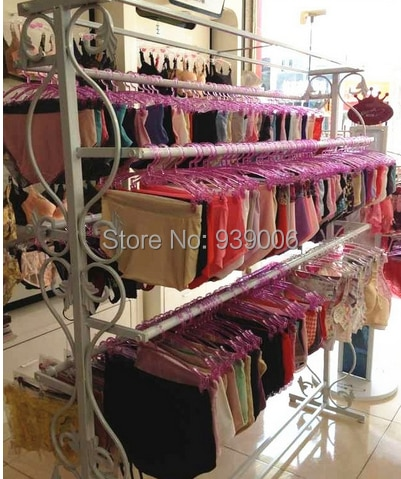 Wrought iron hangers in bra wearing lingerie display console store shelves underwear clothing rack shelf package mail